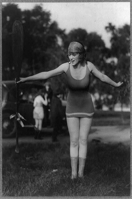 [Mack Sennett girl in bathing suit holding up oar]