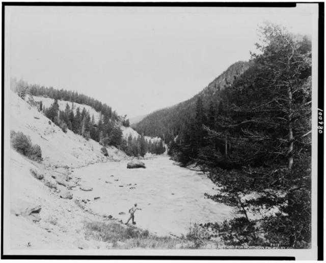 [Man fishing in the Fishin' Hole in the Yellowstone River, Yellowstone National Park, reached by the Northern Pacific Railway via Gardiner Gateway]