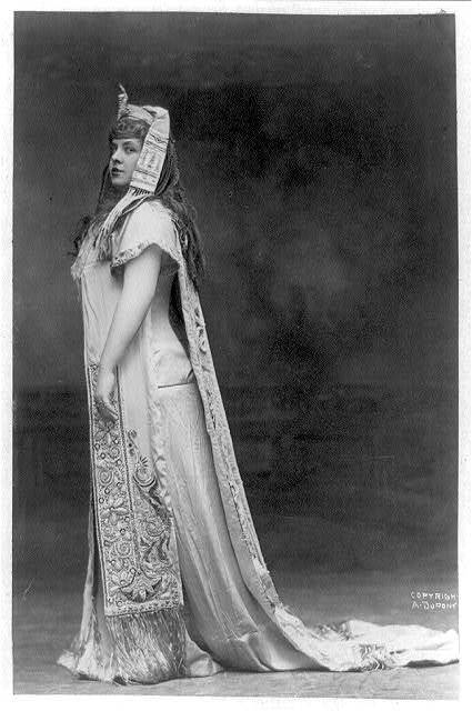 [Maria Gay, full-length portrait, standing, facing left; as Aida in costume with exotic headdress with snake ornament]