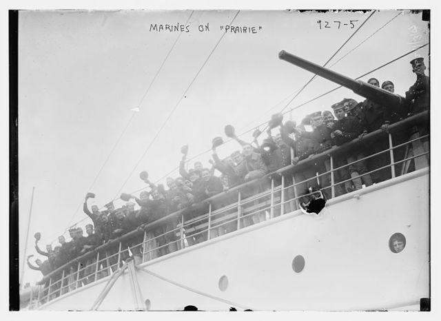 Marines waving from vessel Prairie