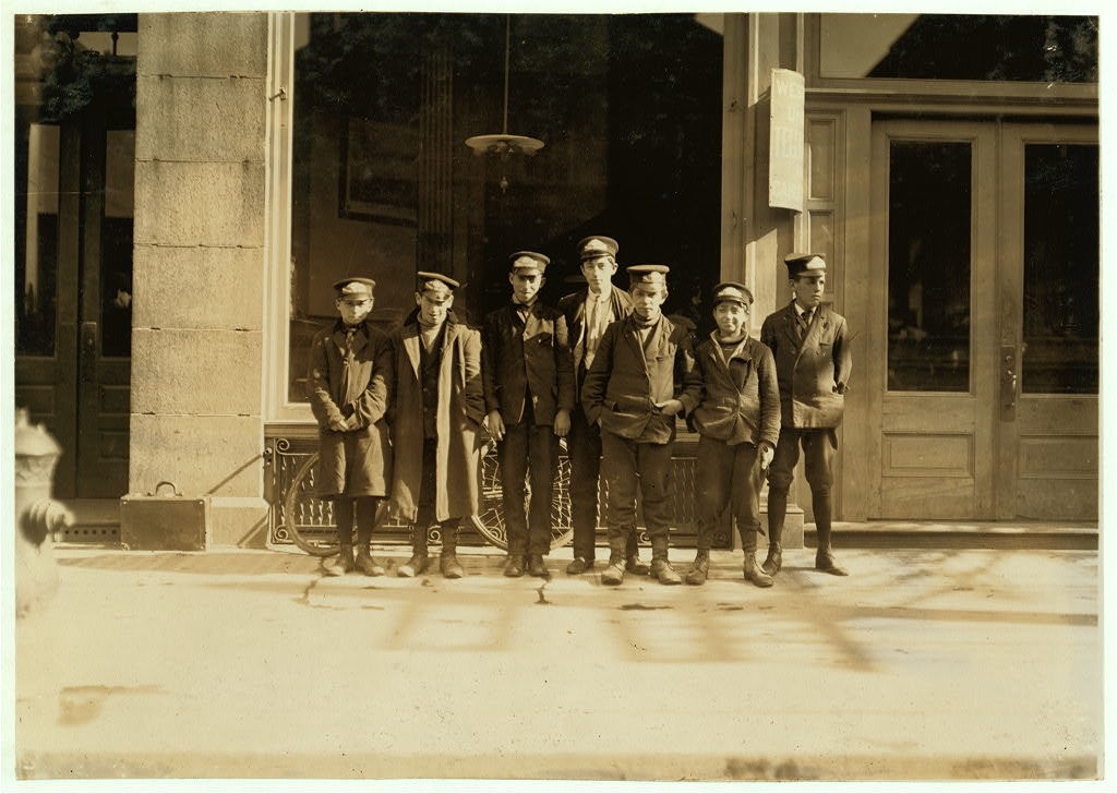 Messenger boys. They work until 11 P.M.  New Haven, Connecticut / Photo by [Lewis W. Hine]