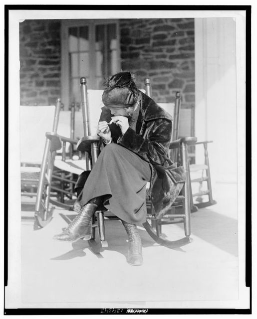 """Miss Sarah Anderson, a Washington suffragist who advocates equal smoking rights for men and women in public places, snaped [sic] as she """"puffed"""" a cigarette at the Chevy Chase Club, Washington's most exclusive country club"""