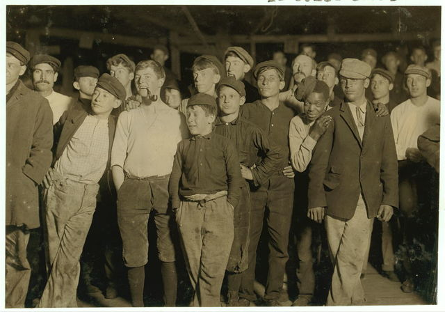Name: A few of the workers on night shift, Cumberland Glass [Works], Bridgeton, N.J. One boy is 13 years old. Nov. 15, 1909.  Location: Bridgeton, New Jersey.