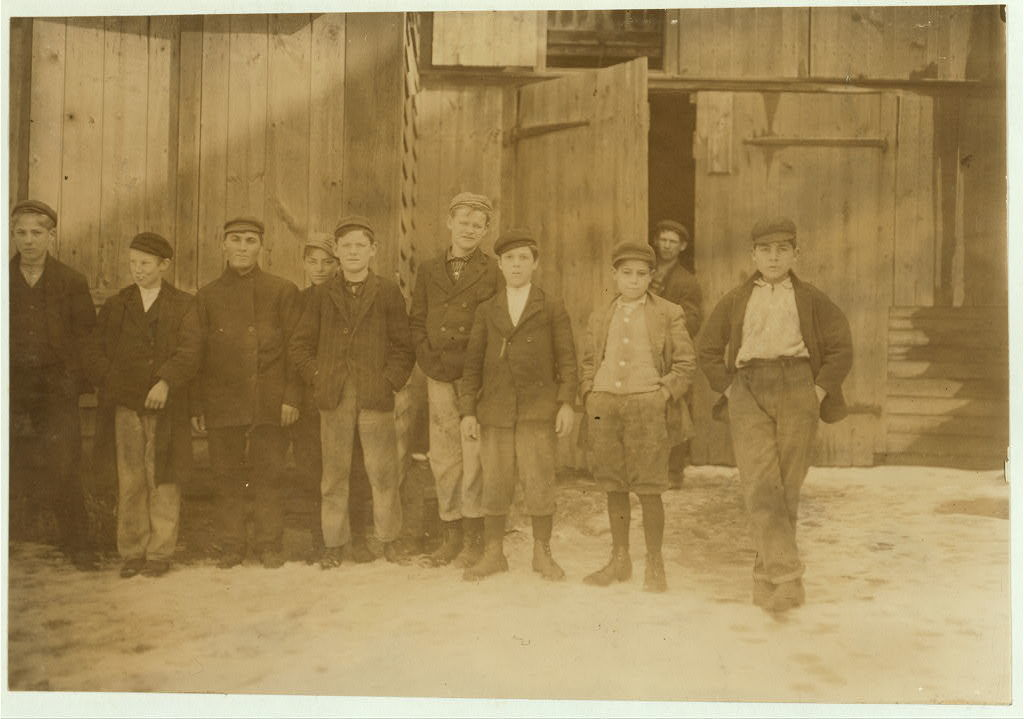 Noon hour. Moore Bros. Glass Co., Clayton, N.J., all are workers.  Location: Clayton, New Jersey / Photo by Lewis W. Hine.