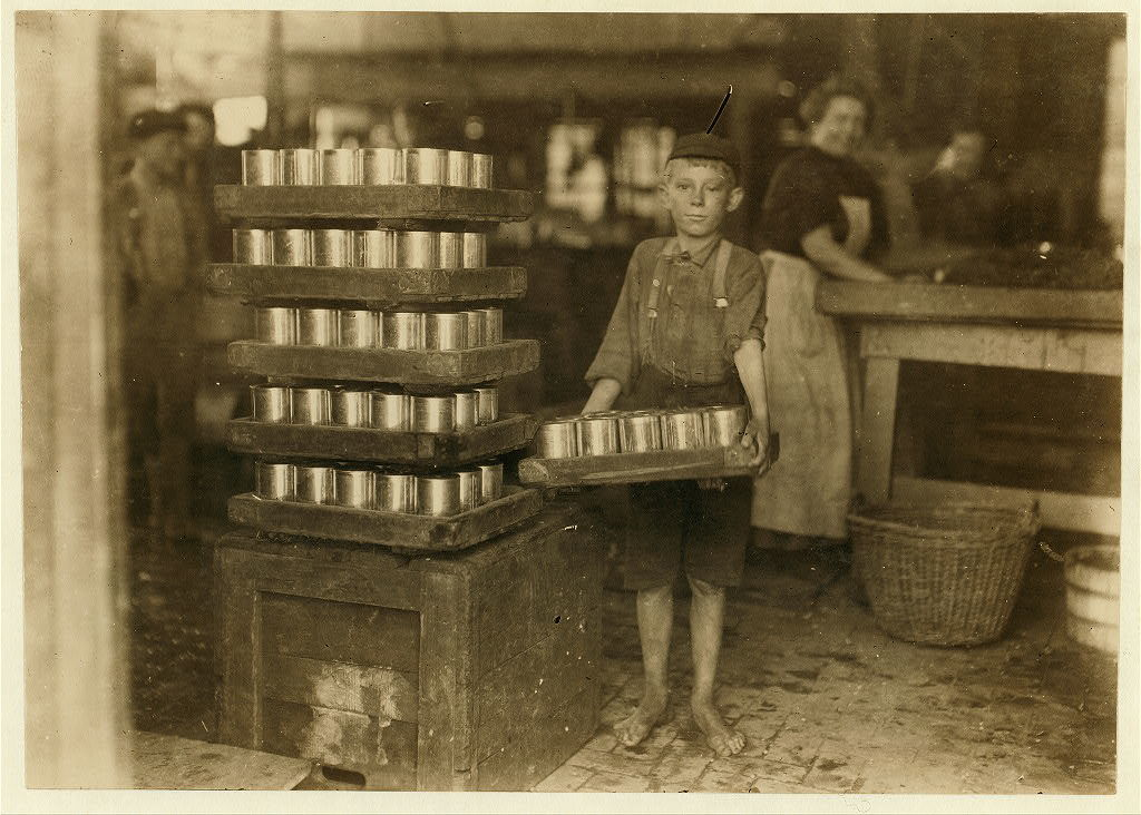 One of the small boys in J. S. Farrand P[ac]king Co. and a heavy load. J. W. Magruder, witness.  Location: Baltimore, Maryland.