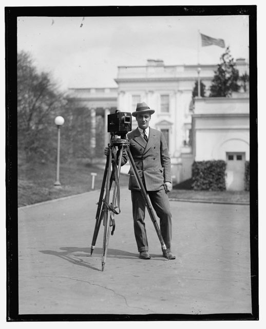 [Photographer with camera outside White House]