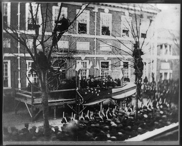 [President-elect Abraham Lincoln raising a flag at Independence Hall, Philadelphia, in honor of the new star added for the admission of Kansas to the Union on Washington's Birthday, February 22, 1861]