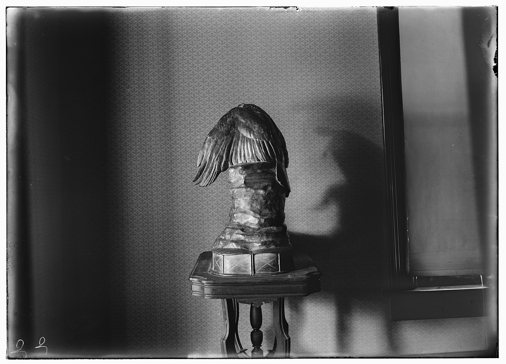[Rear view of the Muse of Aviation trophy as displayed on a table in Orville's home, Hawthorn Hill; Dayton, Ohio]