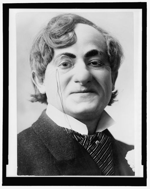 [Sam Bernard, head-and-shoulders portrait, facing right, wearing monocle, as Herman Schultz in The girl and the wizard]