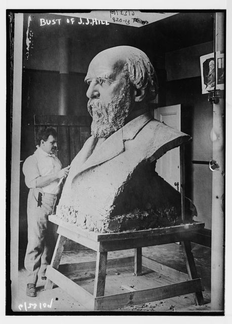 Sculptor working on bust of J.J. Hill
