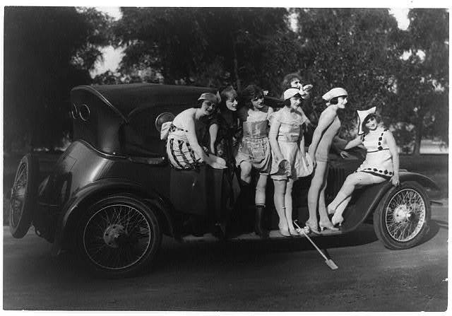 [Seven Mack Sennett bathing beauties standing around a car]
