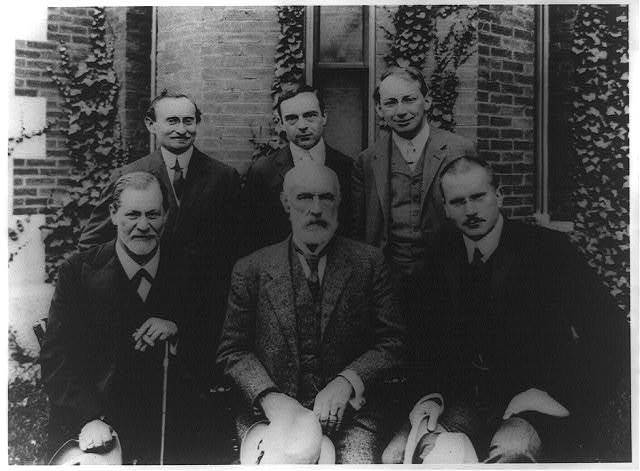 [Sigmund Freud, G. Stanley Hall, C.G. Jung, A.A. Brill, Ernest Jones, and Sándor Ferenczi posed at Clark University, Worcester, Mass.]