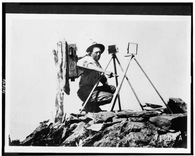 [Signal station in the Rockies, showing telephone installation and signal man using heliograph]