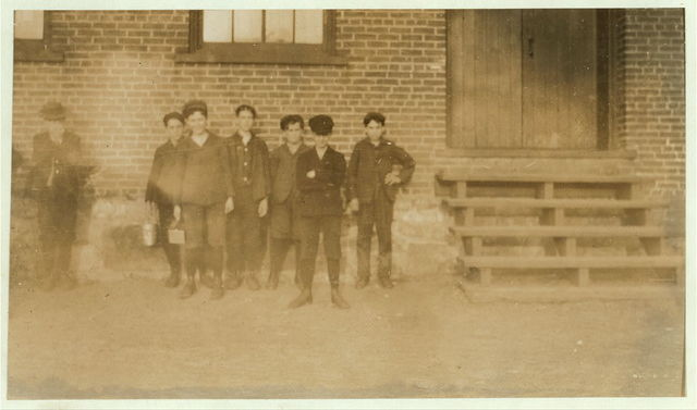 Some of the boys working in Chace Cotton Mill, Burlington, Vermont (see label to photo #730) for names. May 5, 1909. 6 P.M. [Caption #730: All these small boys, and more, work in the Chace Cotton Mill, Burlington, Vt. Many of the smallest ones have been there from one to three years. Only a few could speak English. These are the names of some:- Lahule Julian, Walter Walker, Herman Rotte, Arsone Lussier, Addones Oduet, Arthur Oduet, Alder Campbell, Eddie Marcotte, John Lavigne, Jo Bowdeon, Phil Lecryer, Joseph Granger. A small mill.]  Location: Burlington, Vermont.