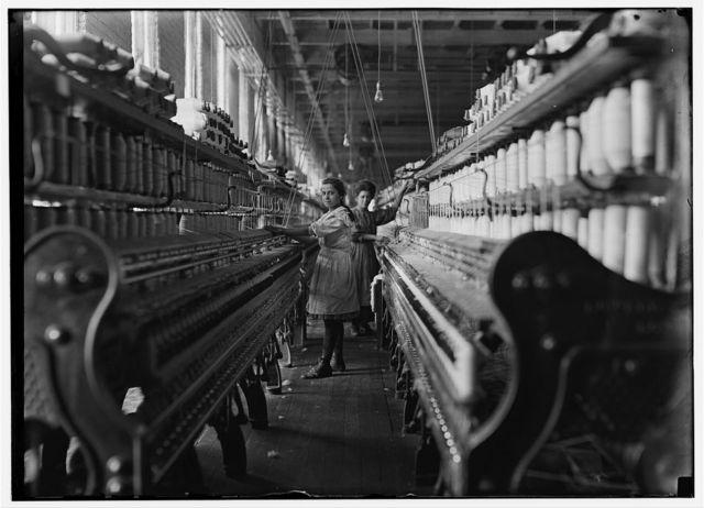 Spinner in Bibb Mil No. 1, Macon, Ga. Bad lighting and ventilation in spinning room.  Location: Macon, Georgia.