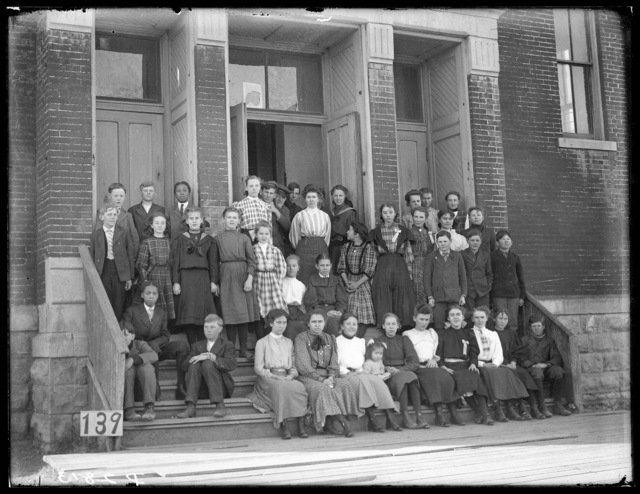 Students and staff in front of a school at Broken Bow, Nebraska
