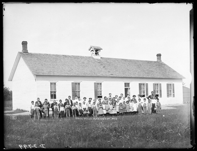 Students and teachers in front of the old school house at Pleasanton, Buffalo County, Nebraska.