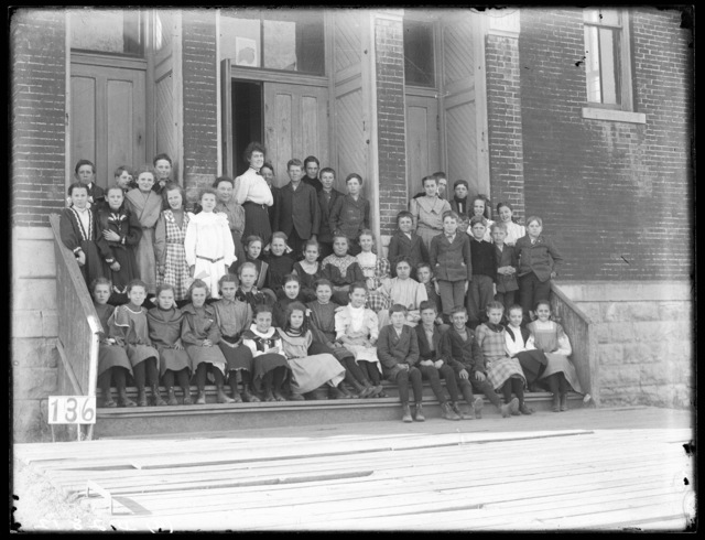 Students and their teachers in front of a school at Broken Bow, Nebraska