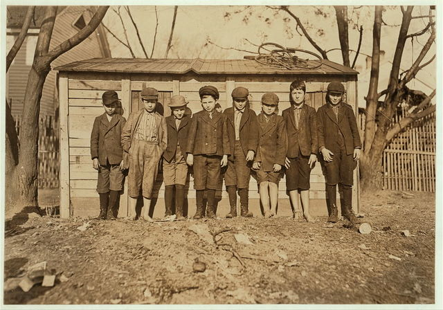Sunday. Boys working in Bibb Mill #1, Macon, Ga. Tallest boy on right hand end (with cap) Grady Olford, been in mill work 5 years. Next, Claudie Bonner. Next, Willie Dix. Next Hermie Allen been in mill work 5 years. Bobbie Dix been in mill work 4 years. Next Alton Wright, been in mill work 1 year. Next David Bonner. (Left hand end shortest boy.) Albert Bowman nearly 4 years in mill. Witness Sara R. Hine.  Location: Macon, Georgia.