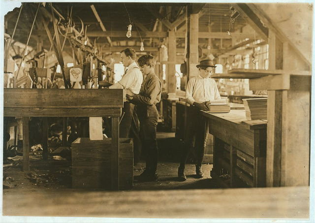 Tampa Cigar Box Factory, Tampa, Fla. Found 10 small boys and girls. Work is slack now. Bad reputation. Jan. 28, 1909.  Location: Tampa, Florida.