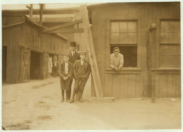 These boys work off and on in Cumberland Glass Works, Bridgeton, N.J. Smallest boy is Geo. Cartwright, 401 N. Laurel St. He says been working off and on since 11 years old.  Location: Bridgeton, New Jersey.