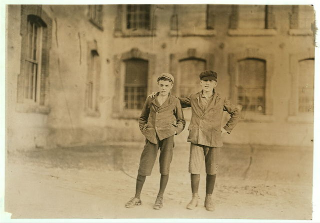 Two boys working in Coventry Co. Mill, Anthony, R. I. 6 P.M. April 16, 1909. I saw about 10 boys and girls who looked to be under 14 years of age.  Location: Anthony, Rhode Island.