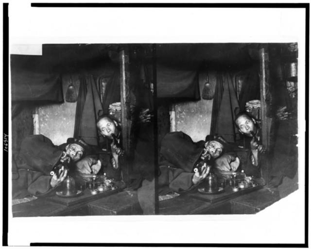 [Two Chinese men, on narcotics in opium den]