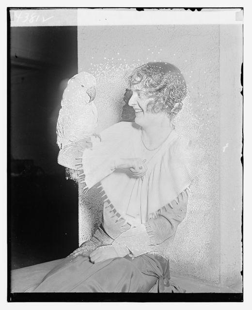 [Unidentified woman holding bird]