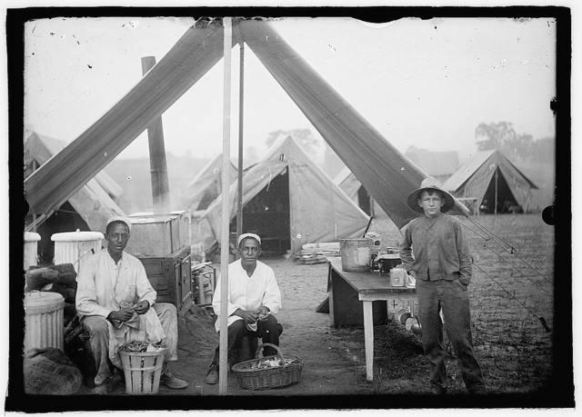 U.S. Army cook tent, peeling potatoes