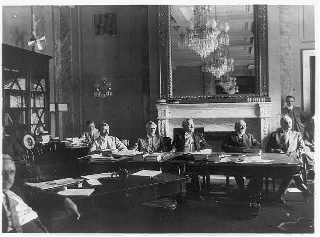 [U.S. Senate Sub-Committee on Labor Investigation, seated at tables covered with papers and fans]