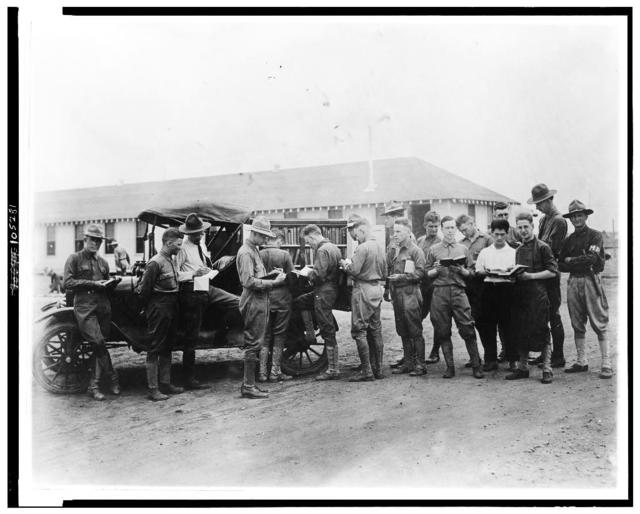 [U.S. soldiers getting library books from truck, Kelly Field Library]