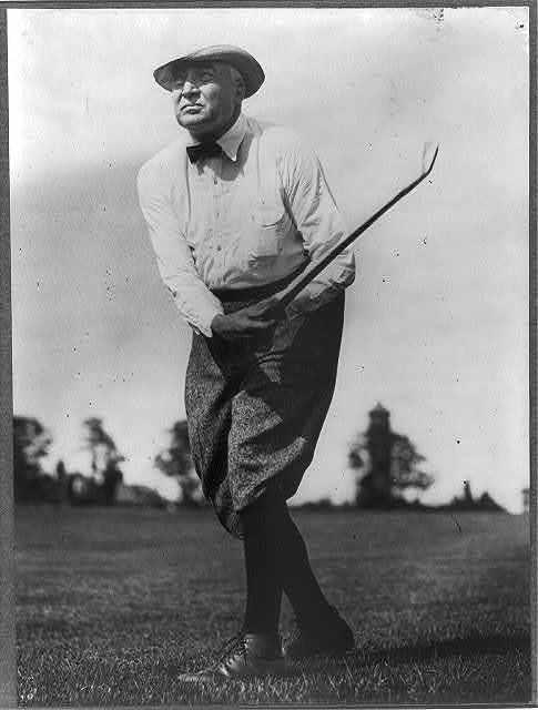 [Warren G. Harding, full length, facing left, swinging golf club]
