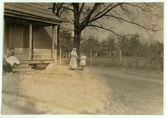 """Woman from Atherton Mill, Charlotte, N.C., and her little girl, evidently her """"helper."""" Superintendent forbade absolutely my taking photos anywhere on the company's premises.  Location: Charlotte, North Carolina."""