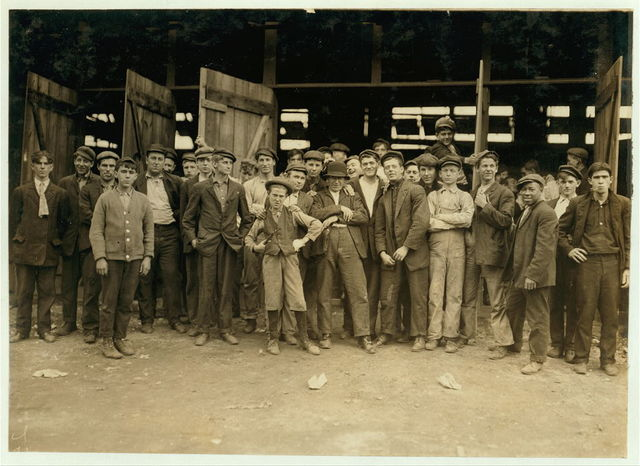 Workers in More-Jones Glass Co., Bridgeton, N.J. Small boy in middle is Harry Simpkins, 52 South Ave. (dirty, noisome conditions). See him in photos 978 & 979.  Location: Bridgeton, New Jersey.