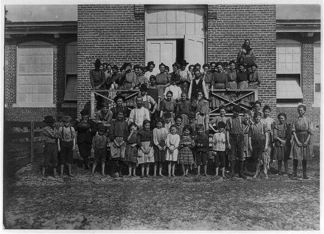 Workers in the Tifton (Ga.) Cotton Mills. All these children were working or helping. 125 workers in all. Some of the smallest boys and girls have been there one year or more.  Location: Tifton, Georgia.