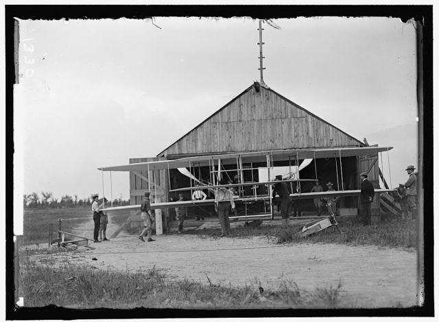 WRIGHT FLIGHTS, FORT MYER, VA, JULY 1909. FIRST ARMY FLIGHTS; HANGAR, ORVILLE WRIGHT, RIGHT