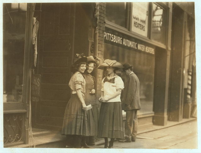 3 girls working in Salvan Medicine Factory and in a Seed Store. Olive near 14th St. Noon, May 12th, 1910.  Location: St. Louis, Missouri.