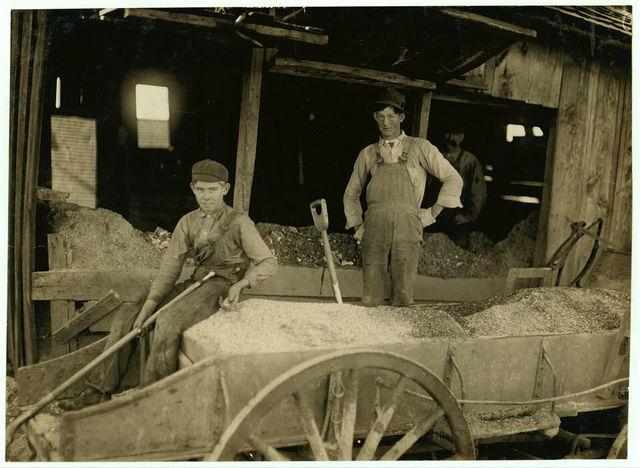 A Boy (may be over 14) at Heavy Work. Shoveling Ore at Daisy Bell Mine, Aurora, Mo.,.  Location: Aurora, Missouri.