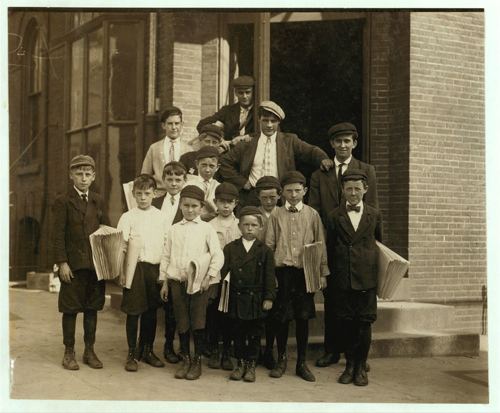 "A gang of newsies at the office of ""Every Evening."" ""Everybody in this gang sells."" Investigator, Edward F. Brown.  Location: Wilmington, Delaware / Photo by Louis [i.e. Lewis] W. Hine, May, 1910."