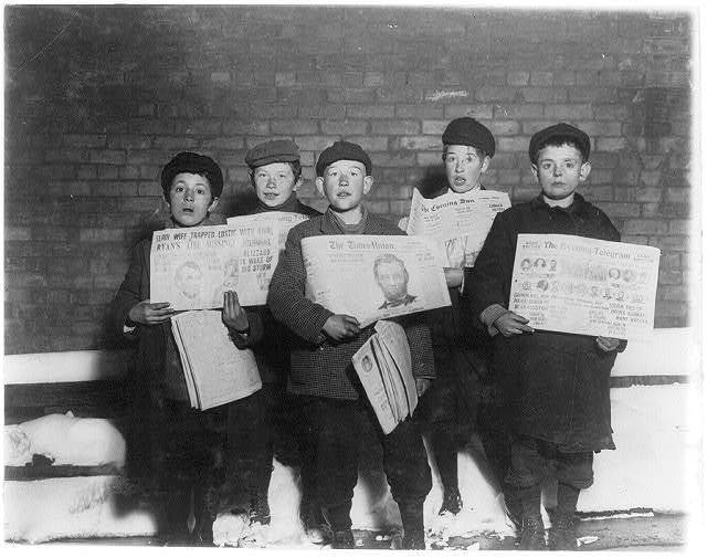 A group of newsies selling evenings in saloons and stores. Taken in alley back of City Jail at 10 P.M. Left to right: Dominick Mardilo, 28 1/2 Fulton Street; Roderick Towle, 44 Sheridan Ave.; William Towle, brother, 44 Sheridan Ave.; Louis Strasburg, 40 Mulberry Street; Max Erlich, 101 Dallius Street.  Location: Albany, New York (State)