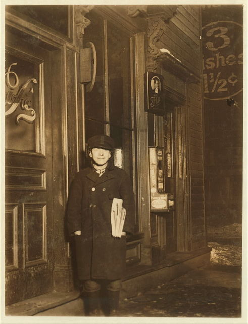 A lone newsie selling at 8 P.M. at the R. R. Station. Peter Fanella, 12 years old, 411 Catherine Street.  Location: Utica, New York (State)