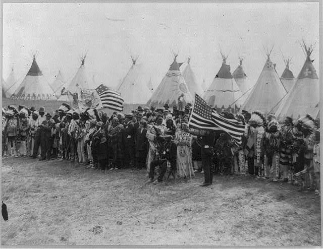A section of the ring of Indians of 20 nations who gathered around the flag pole for the flag raising ceremony on the site of old Fort Union