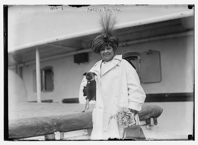 Amelia Bingham carrying dog