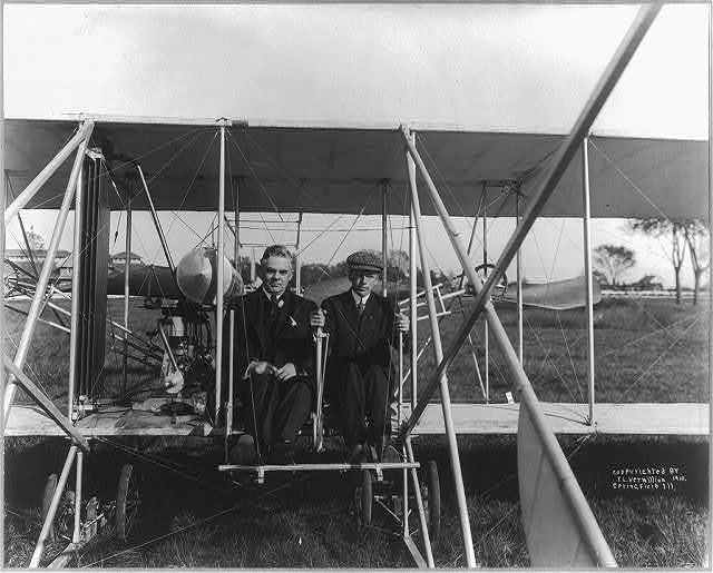 [Arch Hoxsey and Gov. Charles S. Deneen in airplane]