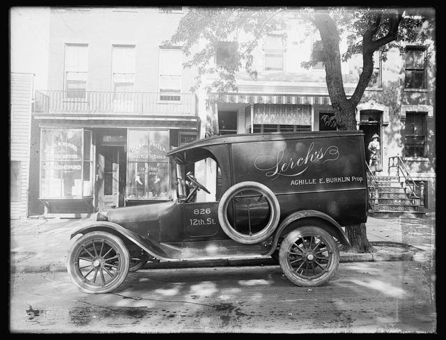 [Automobile with ad for Lerch's, Achille E. Burklin Prop.]