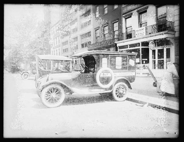 [Automobile with ad for Shefford's Snappy Cheese]