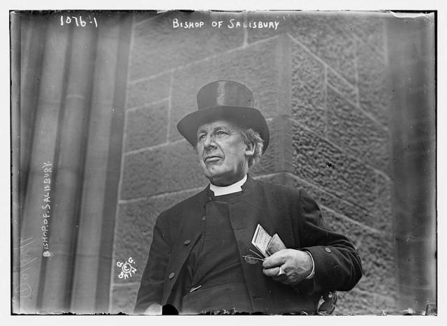 Bishop of Salisbury holding glasses and train schedule