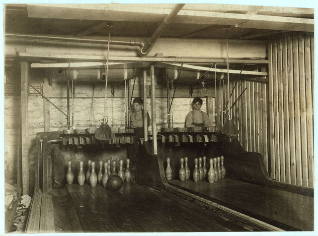 """Bowling Alleys, connected with Geo. P. Grays, """"Bastable Caf """" on Genesee St. About 8 very small boys employed here. Work until midnight. Photo taken at 11:30 P.M.  Location: Syracuse, New York (State)"""