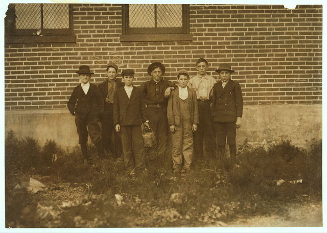 """(Branch of St. Louis firm.) Peter's Shoe Co. Boy on left end is Harry Chrystal, (Add. Box #9, De Soto) an inveterate smoker. He is a """"brusher,"""" gets $3 a week; has worked one summer; is on now """"for the winter."""" Said, after hesitation, when I asked age, """"I'm fourteen."""" Doesn't appear to be. Boy in middle and right end boy seem to be under 14. They are Walter Johnson and Eugene Rieser, and claim to be regular workers. Walter said he had just been """"fired"""" and Eugene had """"got mad and quit.""""  Location: De Soto, Missouri."""