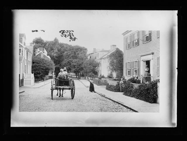 [Carriage in residential street, historic neighborhood]
